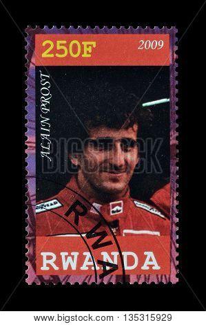 RWANDA - CIRCA 2009 : Cancelled postage stamp printed by Rwanda, that shows Alain Prost.