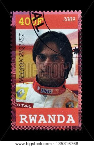 RWANDA - CIRCA 2009 : Cancelled postage stamp printed by Rwanda, that shows Nelson Piquet.