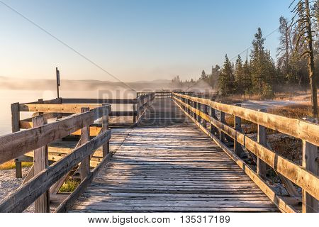 Walkway in the sunrise on a misty morning