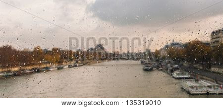 Abstract blurry background with water drops: view through the window Paris France