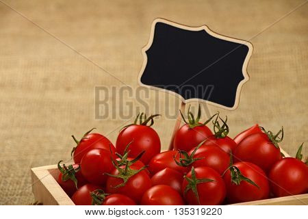 Red Tomatoes In Box With Price Sign Over Canvas
