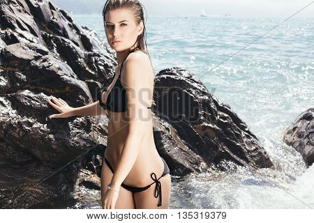 Girl On The Rocky Beach.