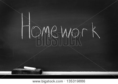 Chalkboard with chalk eraser marks in white chalk Homework Sign