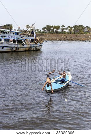 Damietta Egypt - May 13 2016: Young men swimming in river Nile north Egypt.