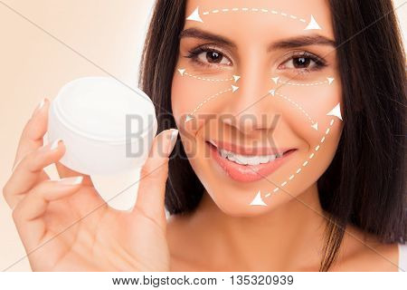 Close Up Photo Of Young Pretty Woman  Holding Jar Of Cream For Face
