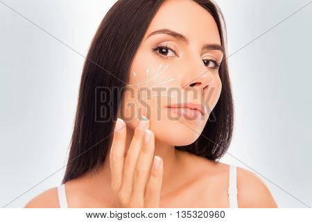 Close Up Portrait Of Pretty Woman Expertising Her Face
