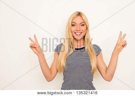 Cheerful Happy Pretty Girl Showing Two Fingers