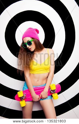 Portrait Of Sexy Slim Woman In Hat And Glasses With Skate