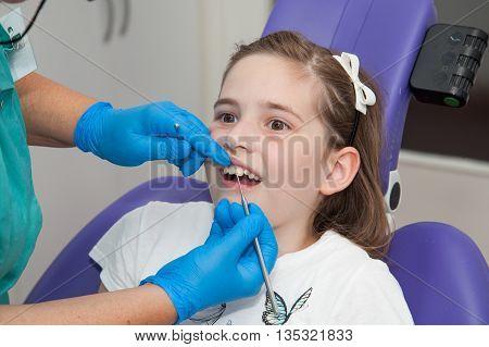 girl on dentist chair at a dentist examination