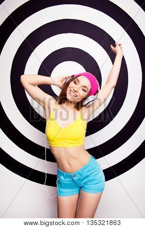 Relaxed Young Girl Listening Music In Headphones And Dancing