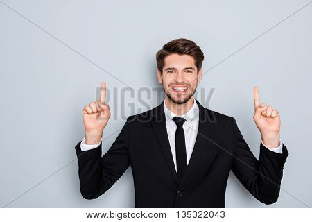 Handsome Smiling Man In Suit Gesturing Up With Fingers