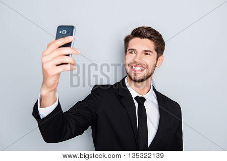 Handsome Smiling Man In Black Suit Making Selfie