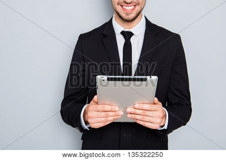 Close Up Portrait Of Smiling Man In Suit Holding Tablet