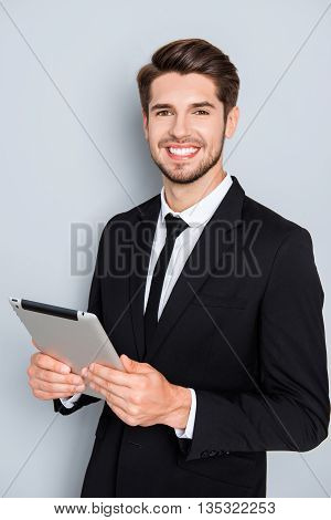 Happy Successful Young Businessman Holding Digital Tablet