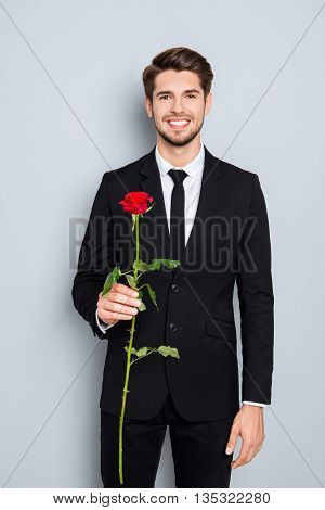 Portrait Of Handsome Happy Man Holding Red Rose