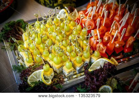 Catering service. Restaurant table with food at event. Top view