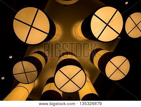 Tube chandeliers from underneath in large ballroom