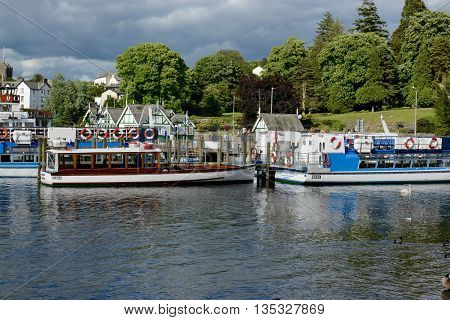 BOWNESS ON WINDERMERE, UK -  JUNE 20, 2016: Pleasure cruise boats at the pier, Bowness on Windermere, Cumbria, UK