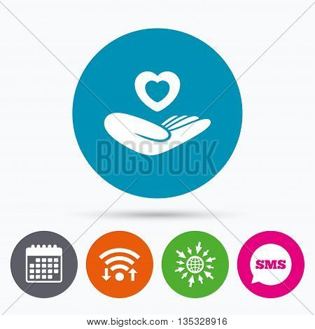 Wifi, Sms and calendar icons. Life insurance sign. Hand holds human heart symbol. Health insurance. Go to web globe.