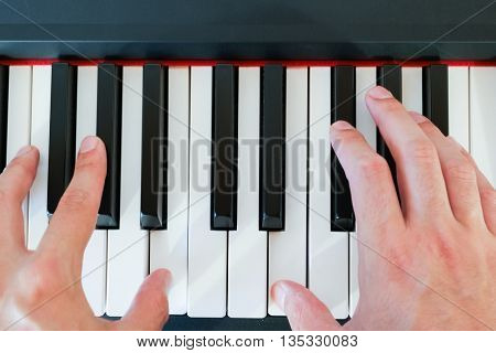 Close up of musician hands playing a piano keyboard