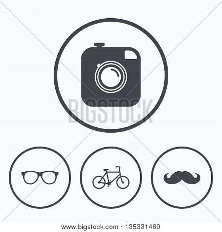 Hipster photo camera with mustache icon. Glasses symbol. Bicycle family vehicle sign. Icons in circles.