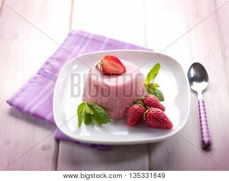 strawberry mousse with mint leaf, selective focus