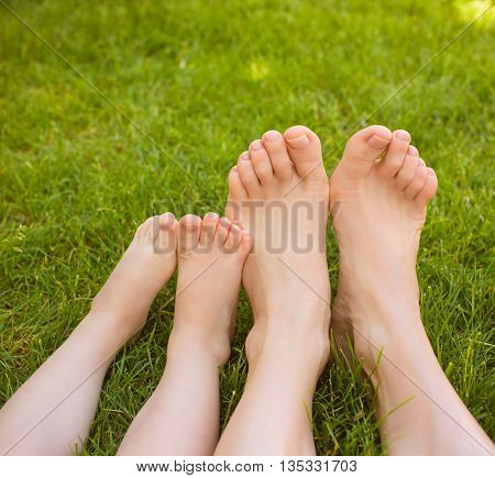 Mother and little baby legs laying on the grass