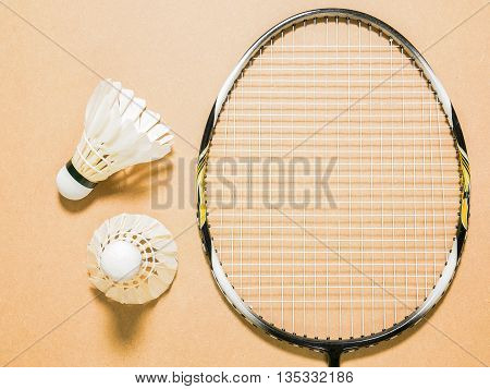 sports set of two shuttlecocks with badminton racket on plywood background