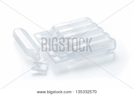Group of modern plastic BFS (Blow Fill Seal) ampules one opened and pack of closed. Isolated on white with clipping path.