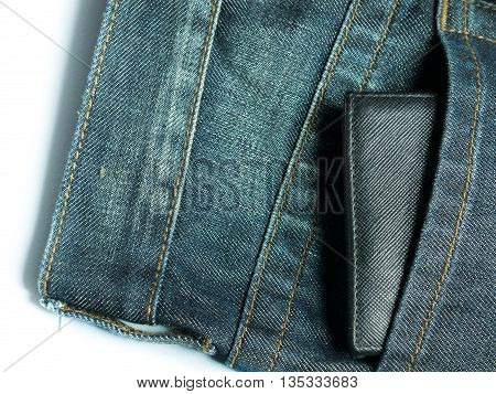 Pocket on blue jeans with balck wallet
