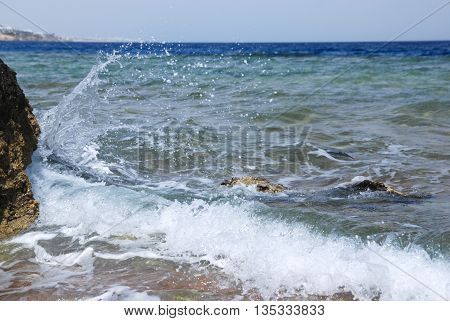Photo of beautiful clear turquoise sea ocean water surface with ripples and bright splash on seascape background, horizontal picture coast beach line.