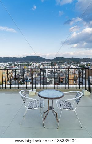 Table and chairs on  roof top terrace exterior