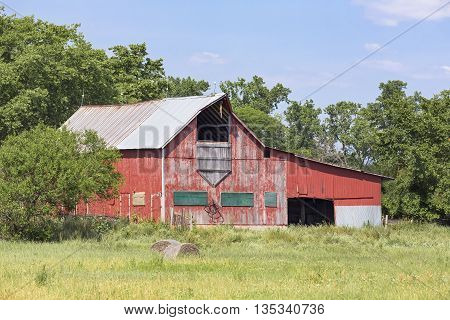A rustic old red barn stands on a farm in rural central Ohio.