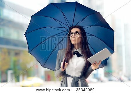 Disappointed  Woman with Glasses, Tablet and Umbrella Out in the City