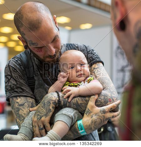 KRAKOW, POLAND - JUNE 12, 2016: Unidentified festival participant at the 11-th International Tattoo Convention in the Congress-EXPO Center of Krakow.
