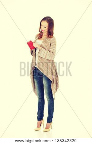 Happy woman with wallet.