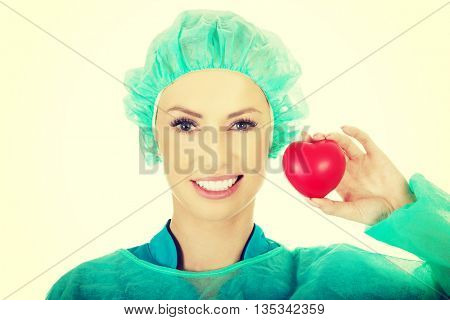 Female surgeon doctor with heart.