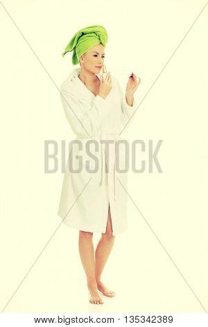 Beautiful woman smelling perfume.