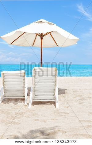 Back Of The Beach Chairs And Umbrellas On Sand