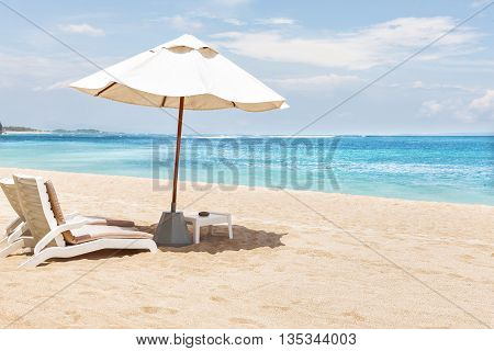 Closeup Of The Sun Beds And Umbrellas On The Sand