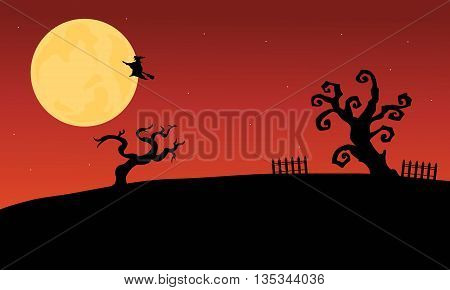 Halloween witch flying and dry tree silhouette with moon backgrounds