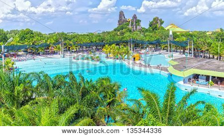 Binh Duong, Vietnam - June 5th, 2016: Lots of tourists bathing water park, swimming enjoy artificial waves, this largest Artificial beach attracts tourists weekend resort in Binh Duong, Vietnam