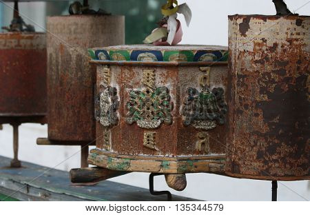 Ancient prayer wheels in major Buddhist monastery in Ulan Ude, Russia.