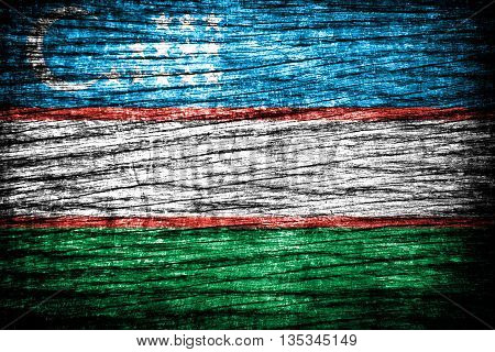 Uzbekistan Flag painted on grunge wall texture background