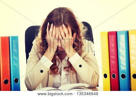 Hardworking businesswoman by a desk.