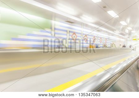 Blurred walkway and people in subway station rush hour concept.