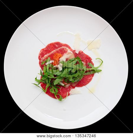 Small portion of beef carpaccio isolated on black background