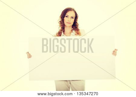 Business woman with empty banner.