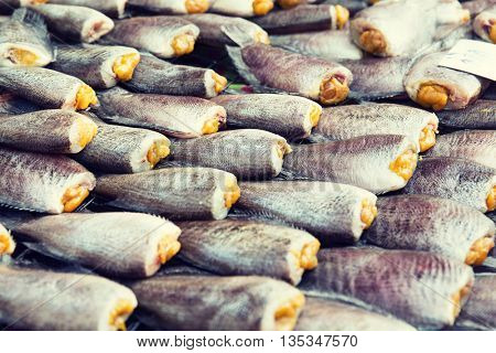 cooking, asian kitchen, sale and food concept - stuffed fish or seafood at asian street market