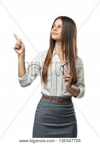Gorgeous young girl standing and showing thumbs up. Cut-out photo. Smiling worker. Hand gesture. Good job. Symbols and gestures. Expression of approval. Successful outcome.